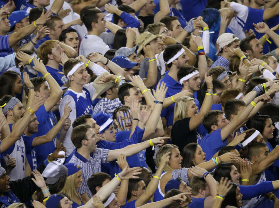 Kentucky fans cheer during the first half of the NCAA Final Four tournament college basketball championship game against Connecticut Monday, April 7, 2014, in Arlington, Texas. (AP Photo/Tony Gutierrez)