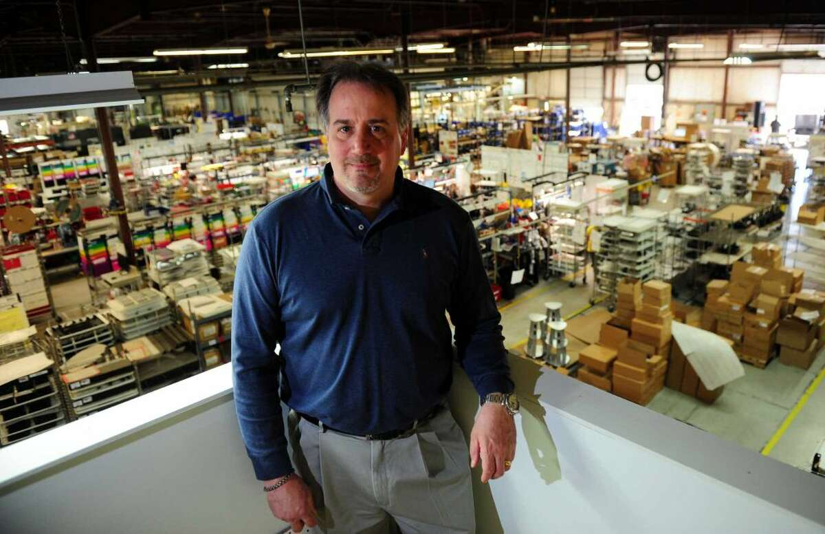 David Black, VP of Engineering at Electri-Cable Assemblies, poses at the factory in Shelton, Conn., on Thursday Apr. 14, An extra federal unemployment tax, which was imposed on businesses after the Great Recession in 2009, will be coming to an end soon.
