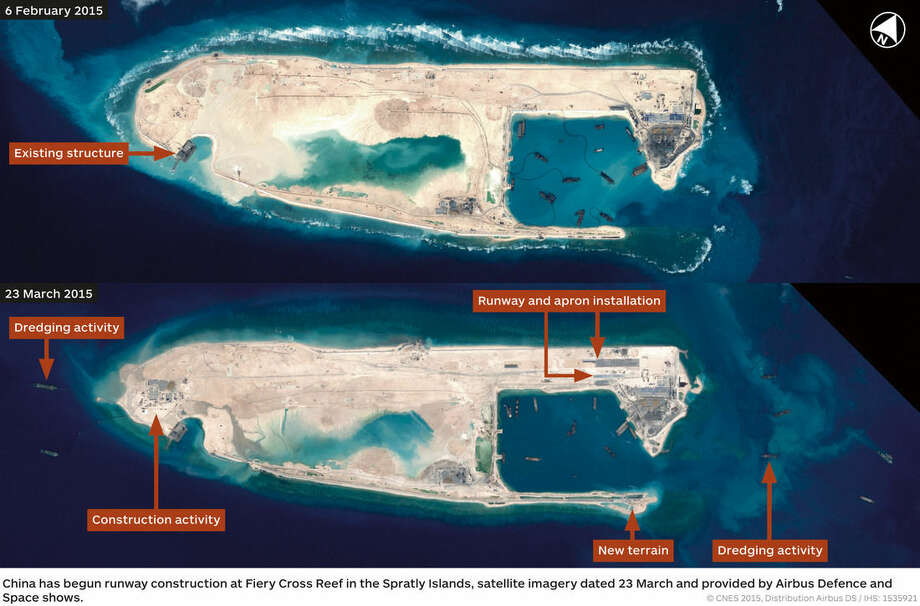 This combination photo of satellite images taken on Feb. 6, 2015, top, and March 23, 2015, bottom, by Airbus Defence and Space, and distributed by IHS Jane's Defence Weekly, shows what IHS Jane's describes as an airstrip on Fiery Cross Reef in a disputed section of the South China Sea. The U.S has warned that China's development on the artificially created island could raise tensions in the area. (CNES, Airbus Defence and Space/IHS Jane's Defence Weekly via AP)