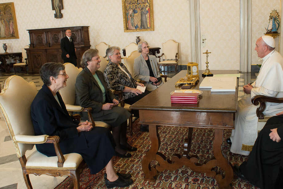 Pope Francis, right, talks with a delegation of The Leadership Conference of Women Religious during an audience in the pontiff's studio at the Vatican, Thursday, April 16, 2015. The Vatican has announced the unexpected conclusion of a controversial overhaul of the main umbrella group of US nuns in a major shift in tone and treatment of American nuns under the social justice-minded Pope Francis. (L'Osservatore Romano/Pool Photo via AP)