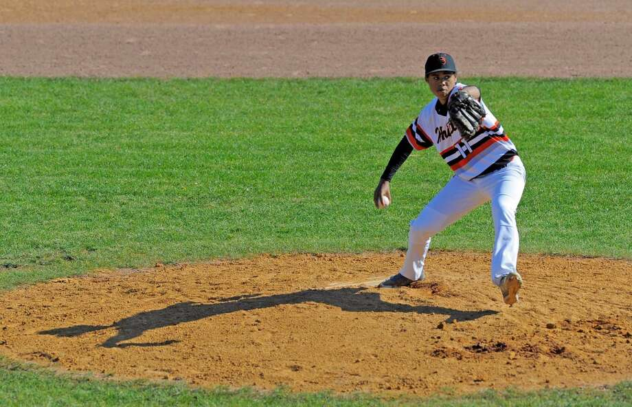 Stamford pitcher Kevin Fuller, who was brought in to relieve Lucas Beldotti in the first inning, delivers a throw in a FCIAC boys baseball game against Norwalk at Stamford High School on April 15, 2016. Norwalk defeated Stamford 8-7.