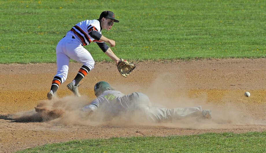 Stamford second baseman Mark Serricchio chases the throw as Norwalk Eddie O'Hara slides past during a FCIAC boys baseball game at Stamford High School on April 15, 2016. Norwalk defeated Stamford 8-7.
