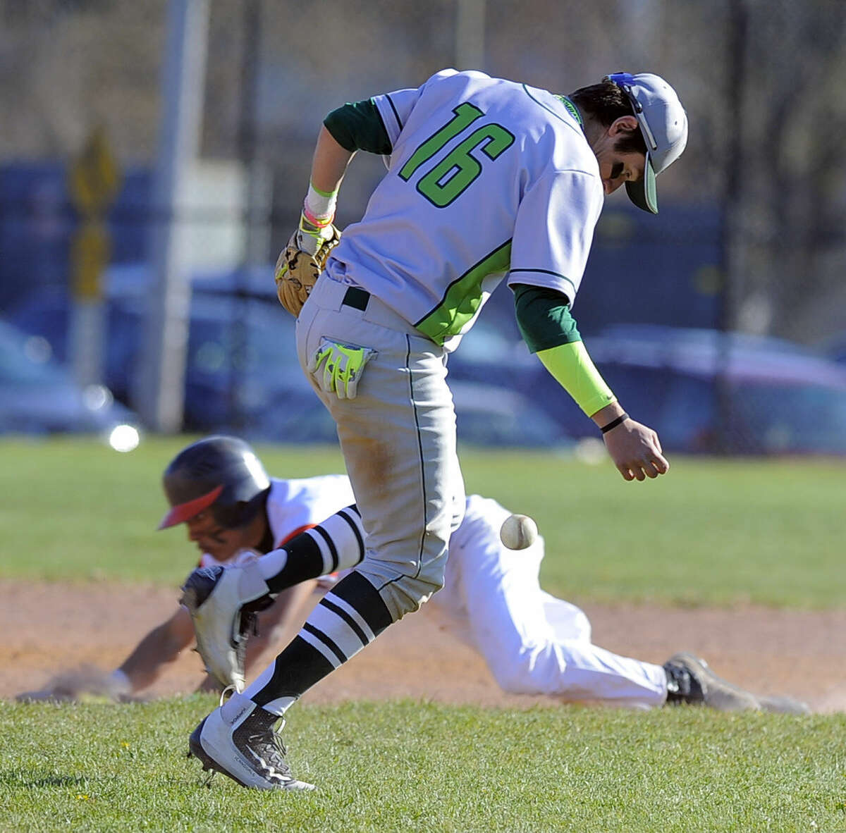 Norwalk shortstop Eddie McCabe bobbles the hit ball of Stamford Ruben Rodriguez in the fourth inning as Jorge Lopez slides into second base during a FCIAC boys baseball game at Stamford High School on April 15, 2016. Norwalk defeated Stamford 8-7.