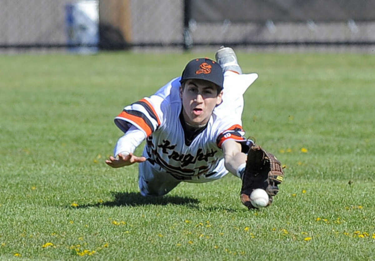 Stamford centerfielder Aaron D'Annolfo dives for Norwalk Eddie O'Hara hit in the first inning of a FCIAC boys baseball game at Stamford High School on April 15, 2016. Norwalk defeated Stamford 8-7.