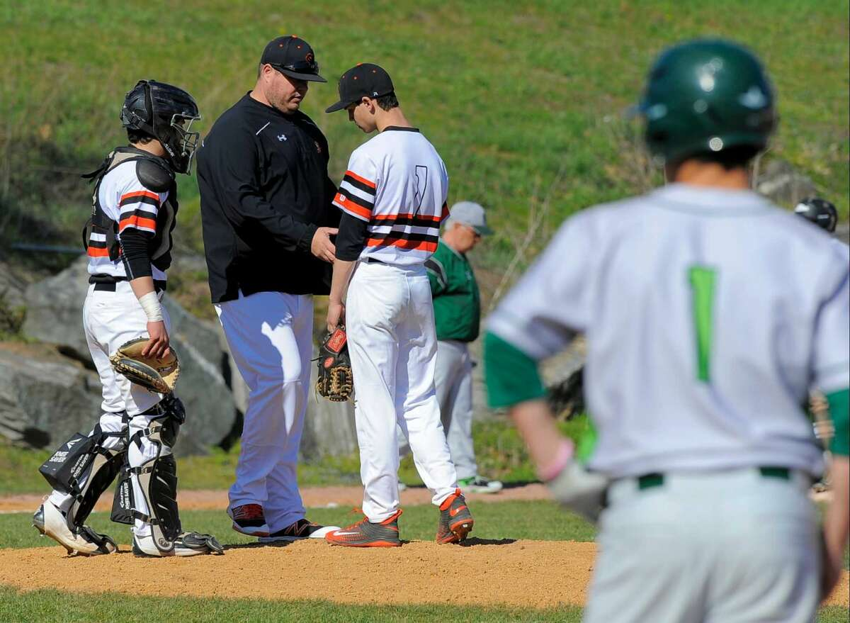 Stamford coach Rit Lacomis pulls starting pitcher Lucas Beldotti in the first inning of a FCIAC boys baseball game against Norwalk at Stamford High School on April 15, 2016. Norwalk defeated Stamford 8-7.