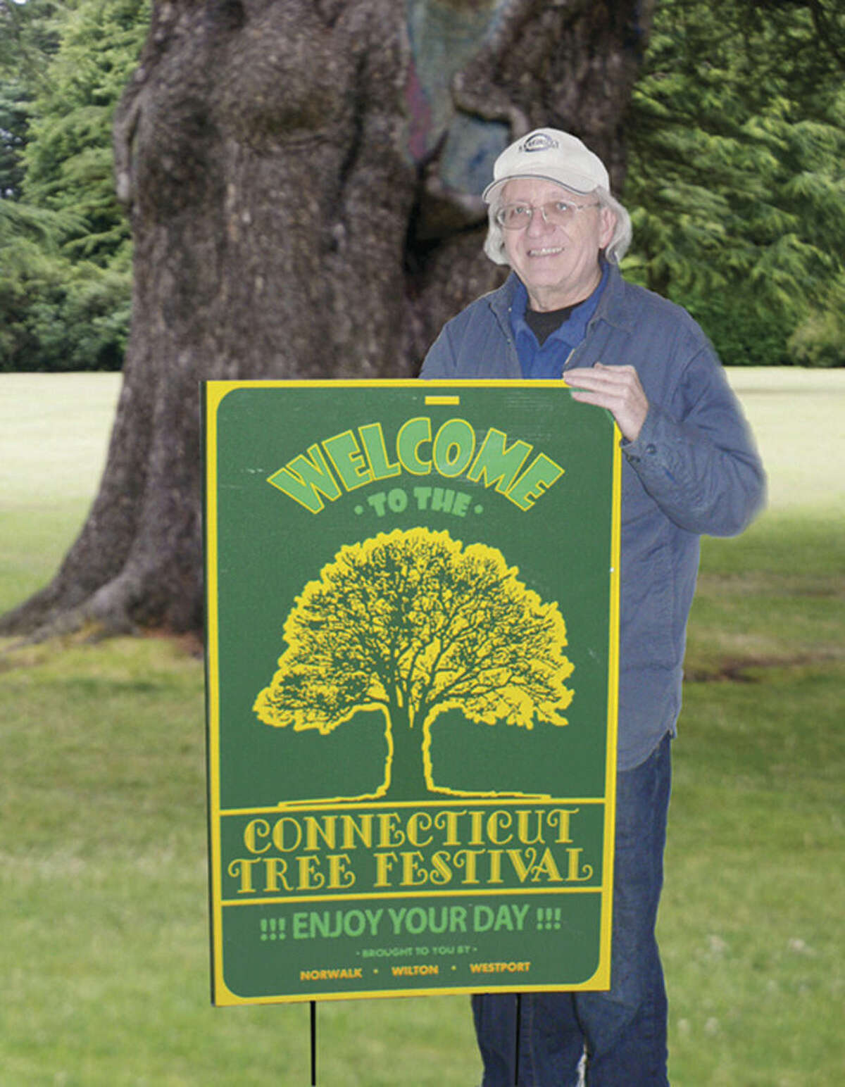 Contributed photo Ron Muller displays signage he created for the Connecticut Tree Festival.
