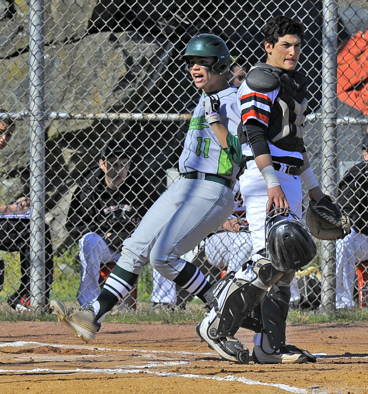 Stamford catcher Nico Kydes reacts as Norwalk Moe Ortiz-Echevarria celebrates scoring in the first inning of a FCIAC boys baseball game at Stamford High School on April 15, 2016. Norwalk defeated Stamford 8-7.