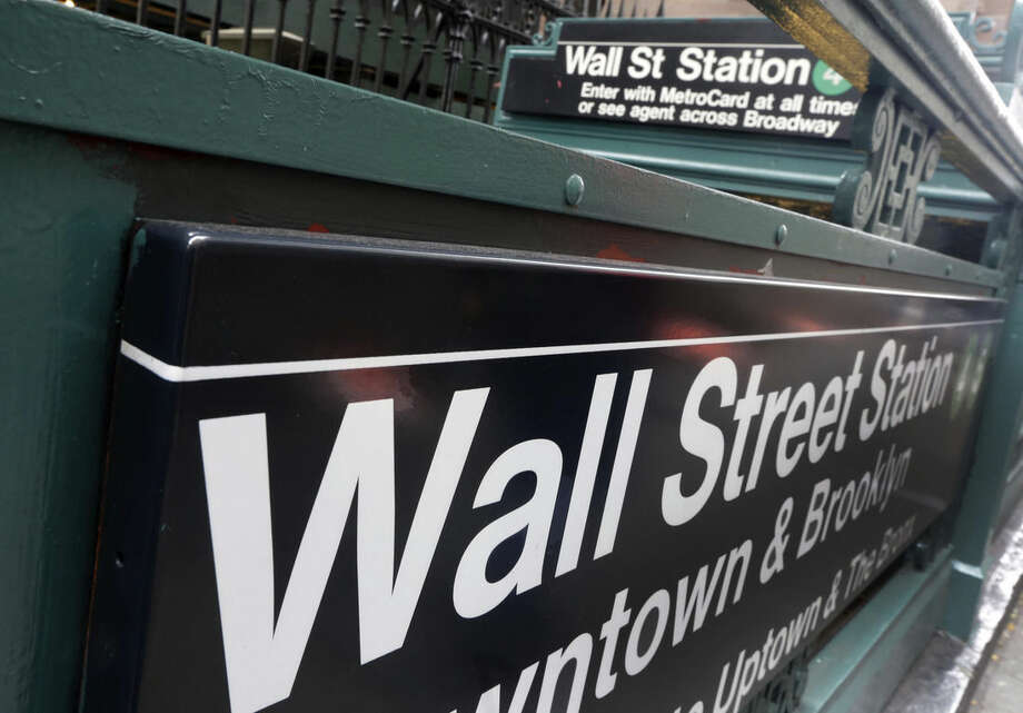 FILE - This Oct. 2, 2014 file photo shows the Wall Street subway stop on Broadway, in New York's Financial District. Asian stocks markets sagged Tuesday, June 16, 2015, as global jitters mounted over whether Greece and its creditors can reach a bailout agreement. (AP Photo/Richard Drew)