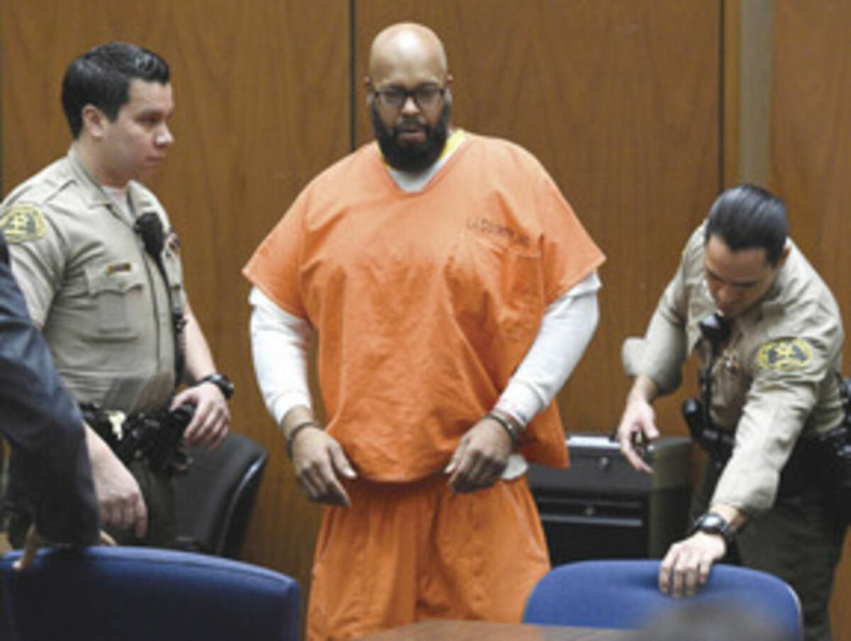 """Kevork Djansezian/Pool Photo via AP In this March 9, 2015 file photo, Marion """"Suge"""" Knight, center, arrives in court for a hearing about evidence in his murder case, in Los Angeles. Knight will stand trial on murder and attempted-murder charges after the former rap music mogul struck two men with his pickup truck in January, killing one and seriously injuring the other."""