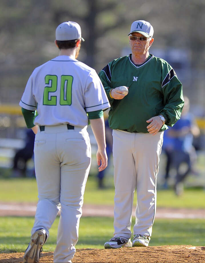 Norwalk coach Pete Tucci hands off the pitching against Stamford to Kyle Pisacrita after pulling starting pitcher Isaac Keehn in the fourth inning of a FCIAC boys baseball game at Stamford High School on April 15, 2016. Norwalk defeated Stamford 8-7.