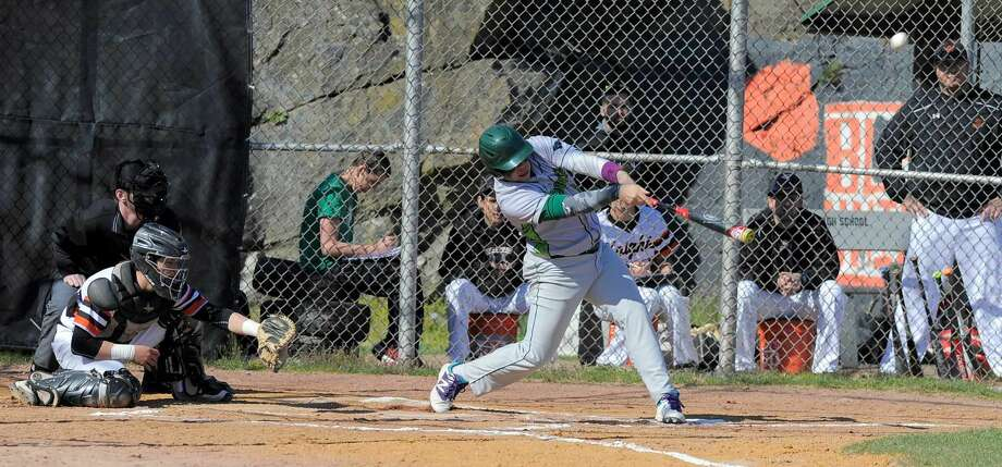 Norwalk Eddie O'Hara drives a hit to centerfield in the first inning against Stamford during a FCIAC boys baseball game at Stamford High School on April 15, 2016. Norwalk defeated Stamford 8-7.