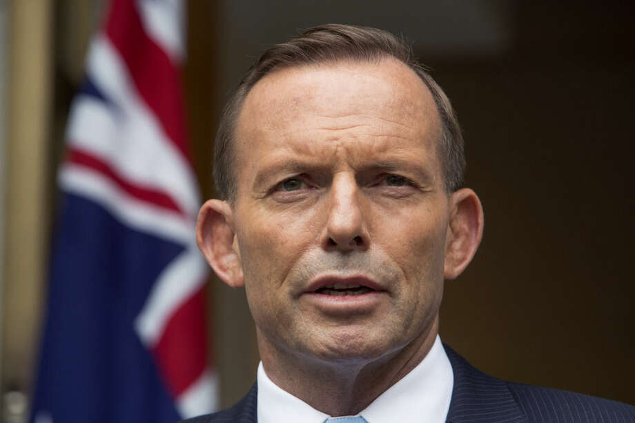 FILE - Australian Prime Minister Tony Abbott answers questions at a media conference before attending the parliament's question time in Canberra, in this Feb. 9, 2015 file photo. Abbott has warned that the terrorism threat in Australia has escalated with one-third of all terrorism-related arrests since 2001 occurring in the last six months. Abbott said the latest alleged plot Saturday April 18, 2015 was at an advanced stage of planning, prompting police to swoop. (AP Photo/Andrew Taylor, File)
