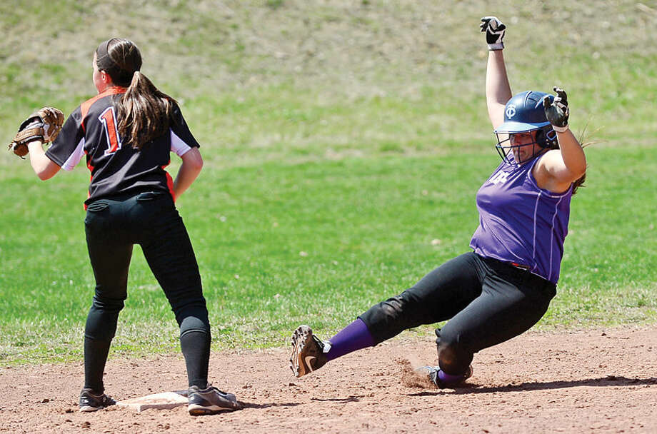 Hour photo / Erik Trautmann Westhill's #27 slides into second during their softball game against Stamford High School Saturday.