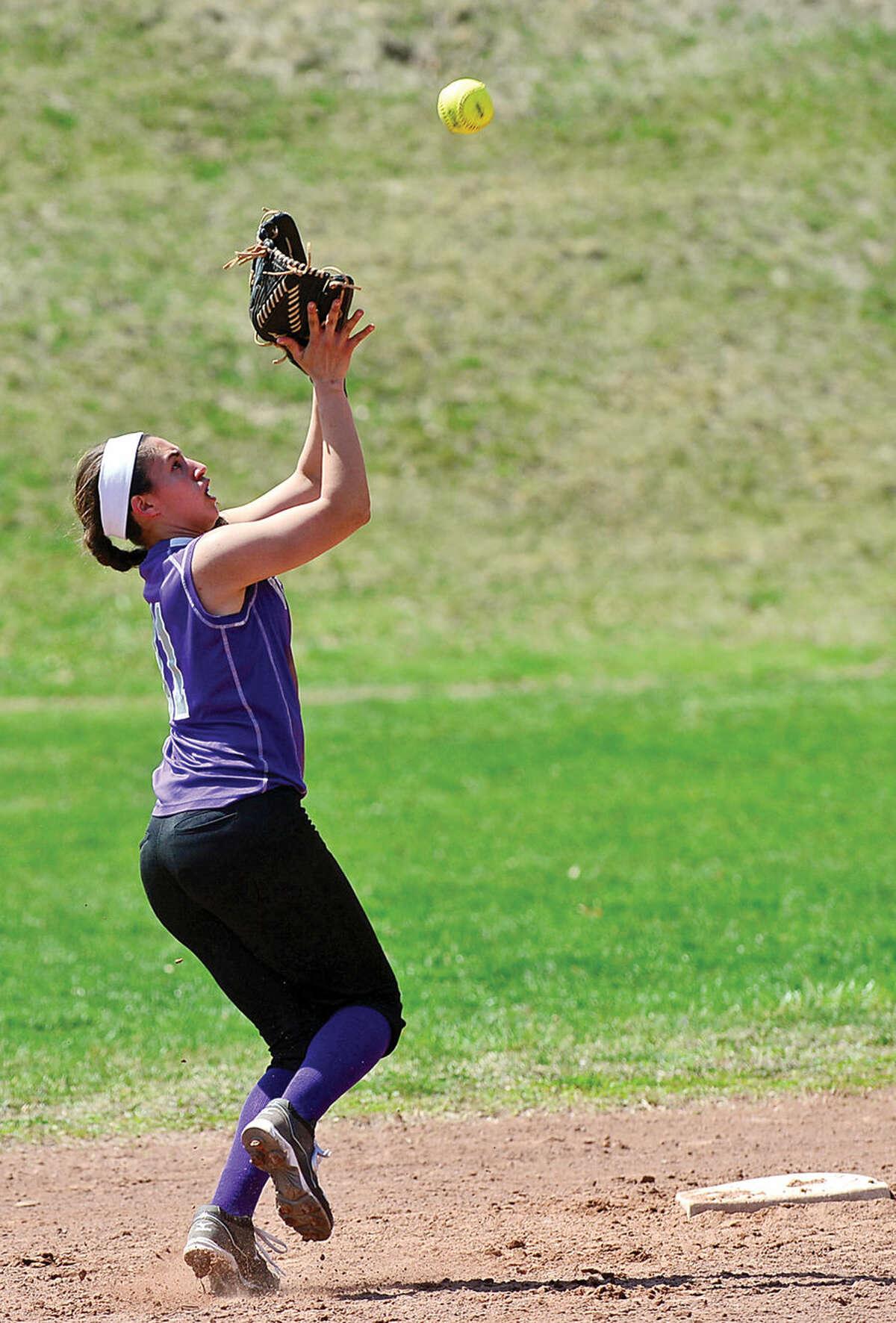 Hour photo / Erik Trautmann Westhill's #11 Gabby Laccola tracks down a fly ball during their softball game against Stamford High School Saturday.