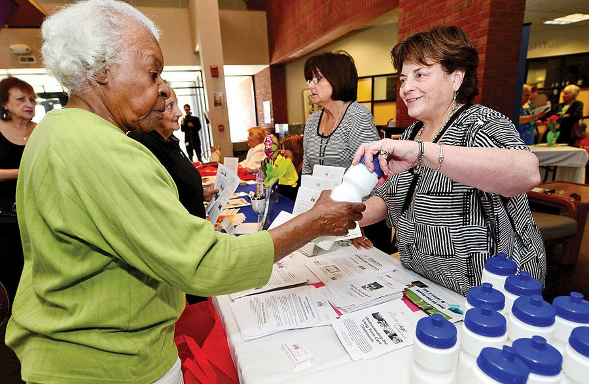Hour photo / Erik Trautmann The Marvin Executive Director Mary Wendt chats with Margaret Lyons during the Norwalk Leadershp Institute Senior Expo Project at the Norwalk Community College where over 25 tables were hosted by local non profit and for profit organizations that provide critical services to Norwalk seniors.