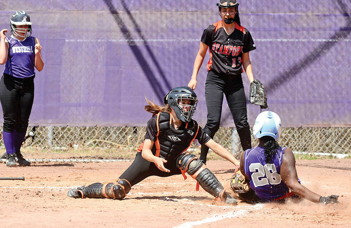 Hour photo / Erik Trautmann Stamford High School's catcher Victoria Cuscuna puts the tag on Westhill's Kaira Ramon during their softball game at Westhill High School Saturday.