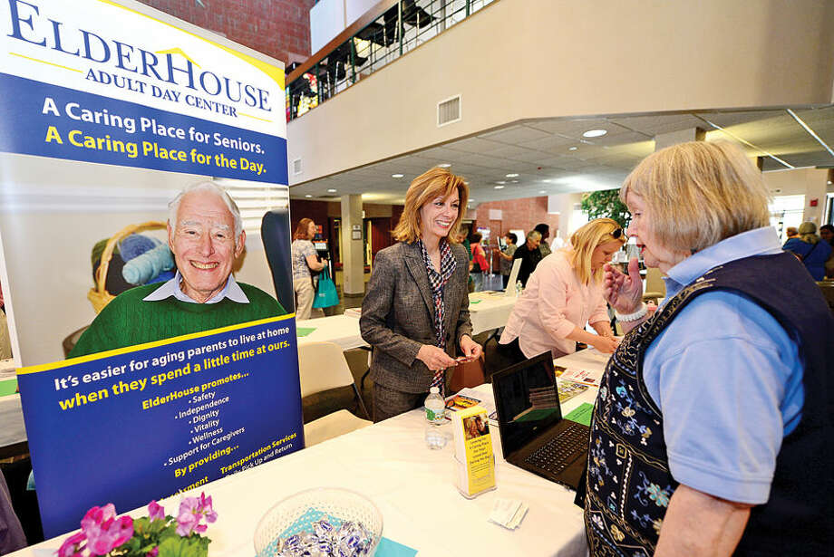 Hour photo / Erik Trautmann Elderhouse Executive Director Denise Cesareo chats with Anne Richards during the Norwalk Leadershp Institute Senior Expo Project at the Norwalk Community College where over 25 tables were hosted by local non profit and for profit organizations that provide critical services to Norwalk seniors.