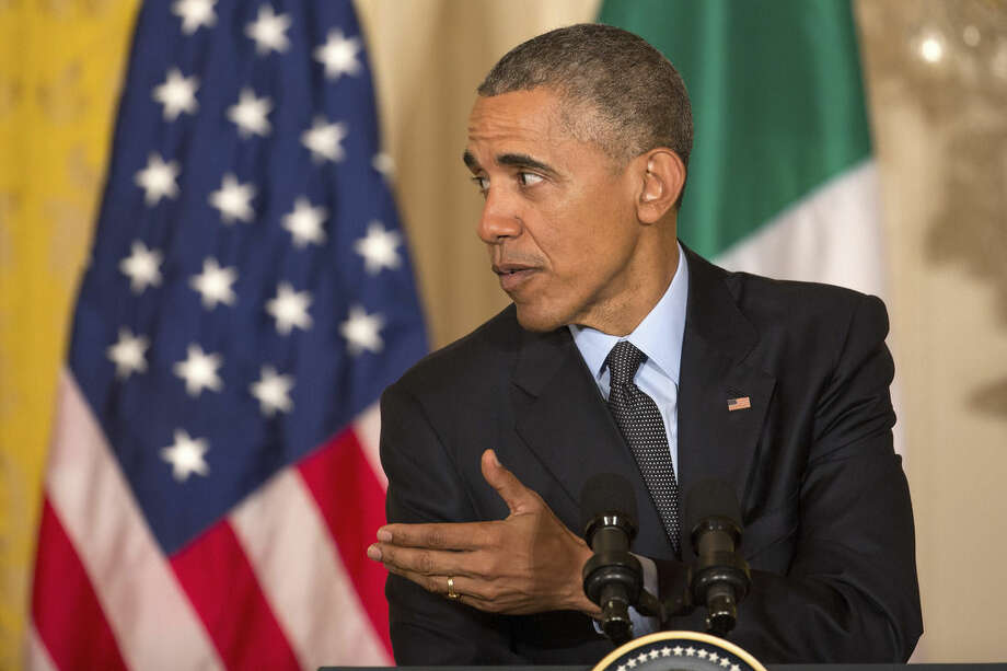 President Barack Obama participates in a joint news conference with Italian Prime Minister Matteo Renzi in the East Room of the White House in Washington, Friday, April 17, 2015. The president hosted the prime minister to discuss issues including Ukraine, Libya and Islamic State militants. (AP Photo/J. David Ake)