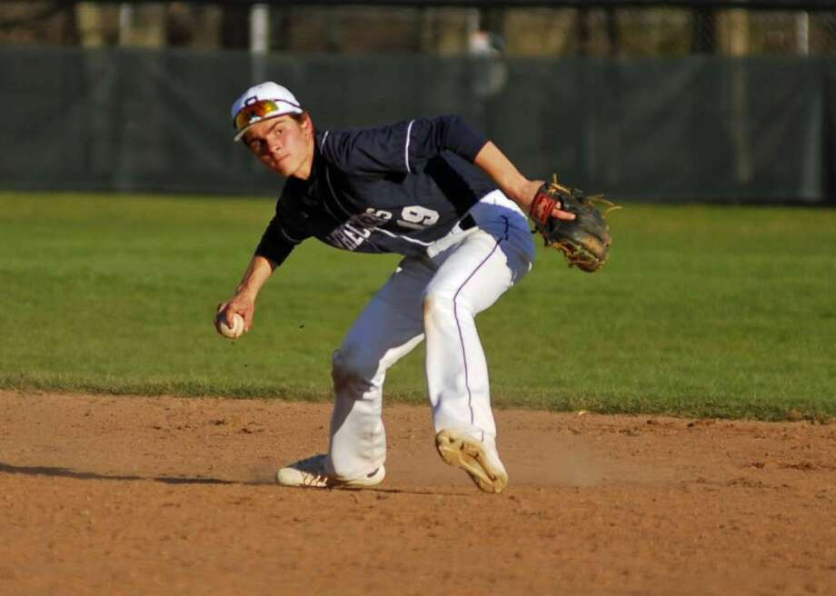 Staples second baseman Max Popken throws to first base during a game against Ridgefield on Friday, April 15th, 2016.