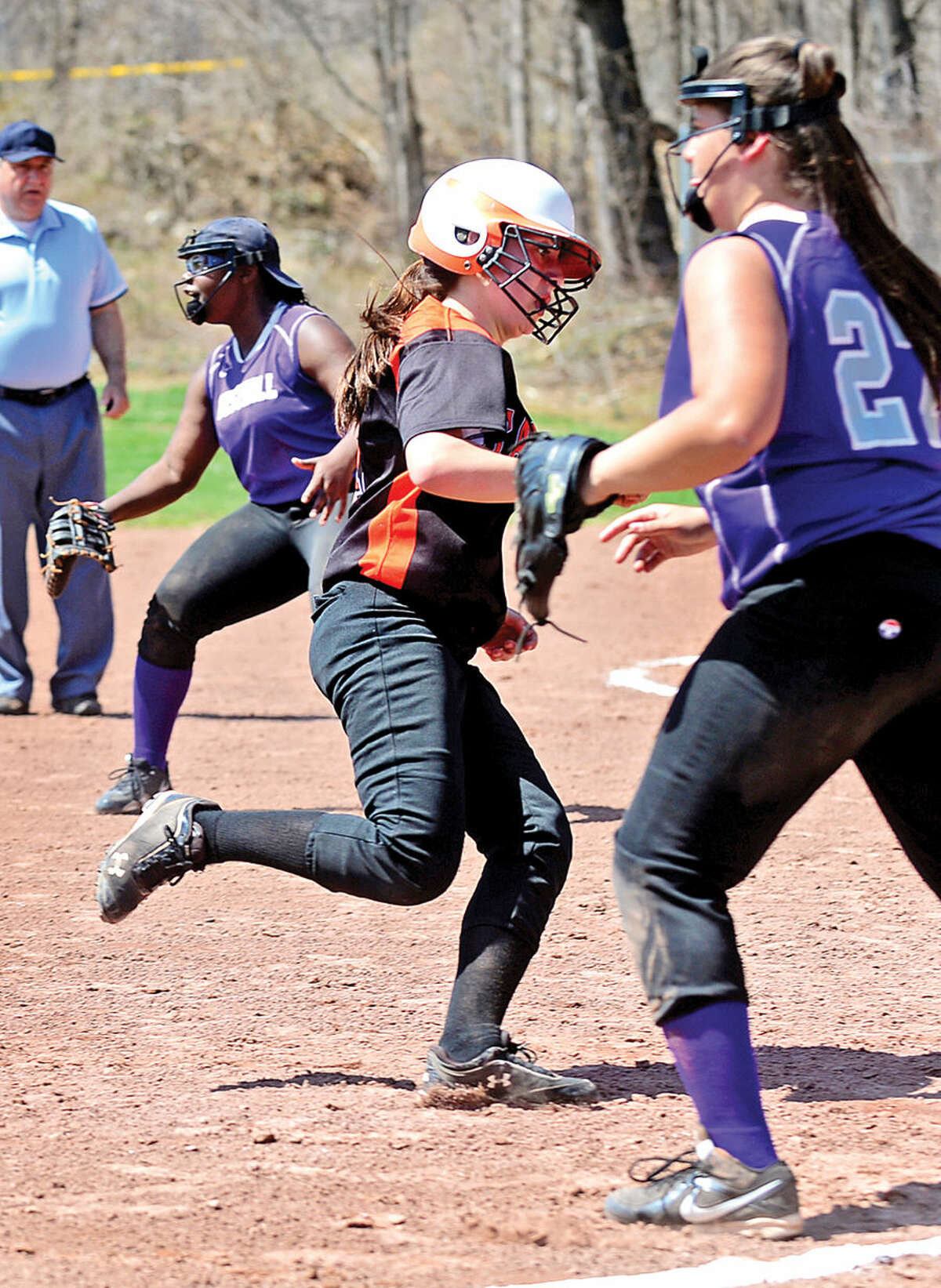 Hour photo / Erik Trautmann Stamford's Allie Buzzeo rounds third for a in the park home run during their softball game against Westhill High School Saturday.