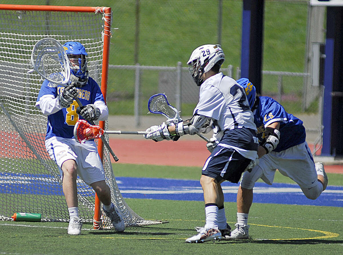 Staples Michael Reale takes a shot at the Kellenberg Memorial cage during a boys lacrosse game on Saturday, April 16th, 2016.