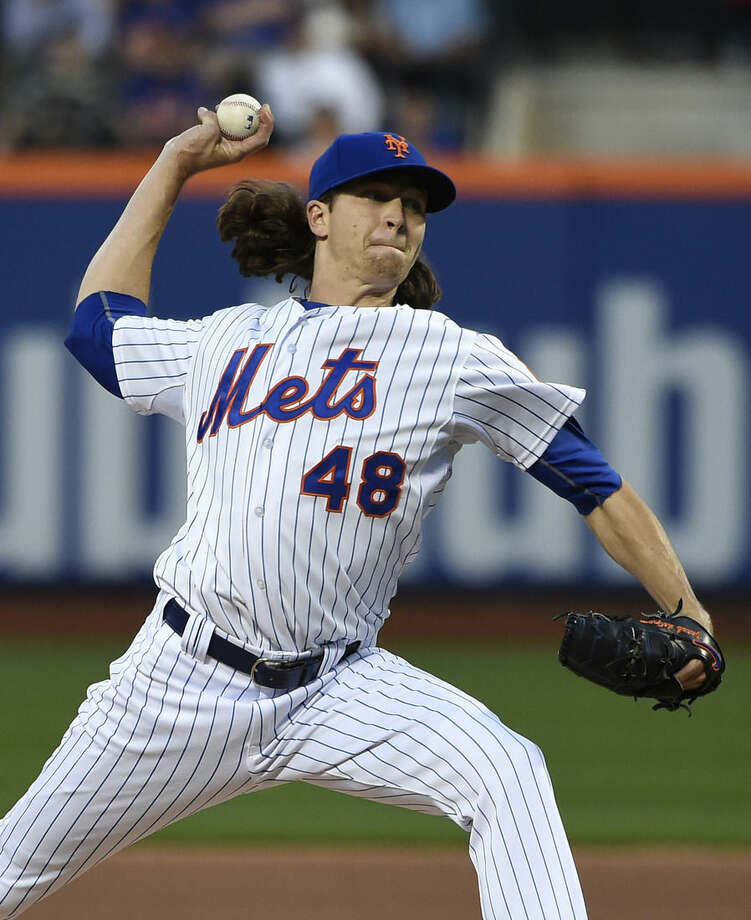 New York Mets starter Jacob deGrom (48) pitches in the first inning of a baseball game against the Miami Marlins at Citi Field on Saturday, April 18, 2015, in New York. (AP Photo/Kathy Kmonicek)