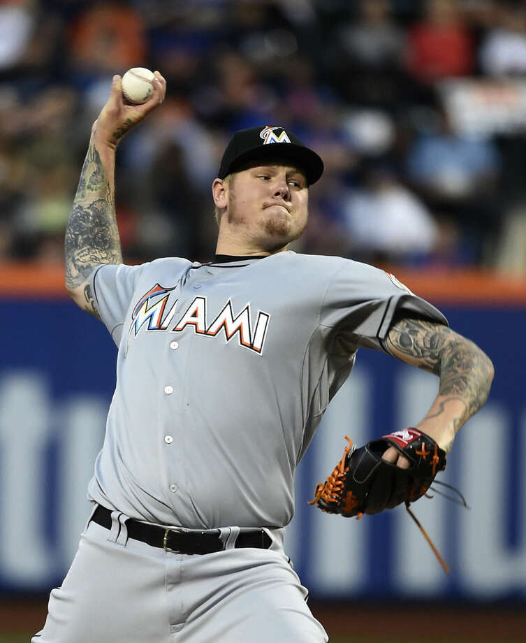 Miami Marlins starter Mat Latos pitches against the New York Mets in the first inning of a baseball game at Citi Field on Saturday, April 18, 2015, in New York. (AP Photo/Kathy Kmonicek)