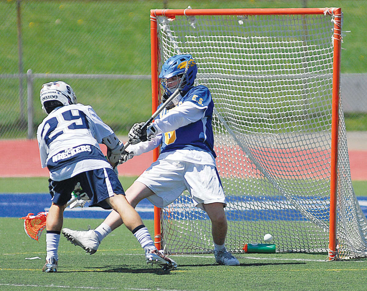 Staples' Michael Reale scores a goal during a boys lacrosse game against Kellenberg Memorial on Saturday, April 16th, 2016.