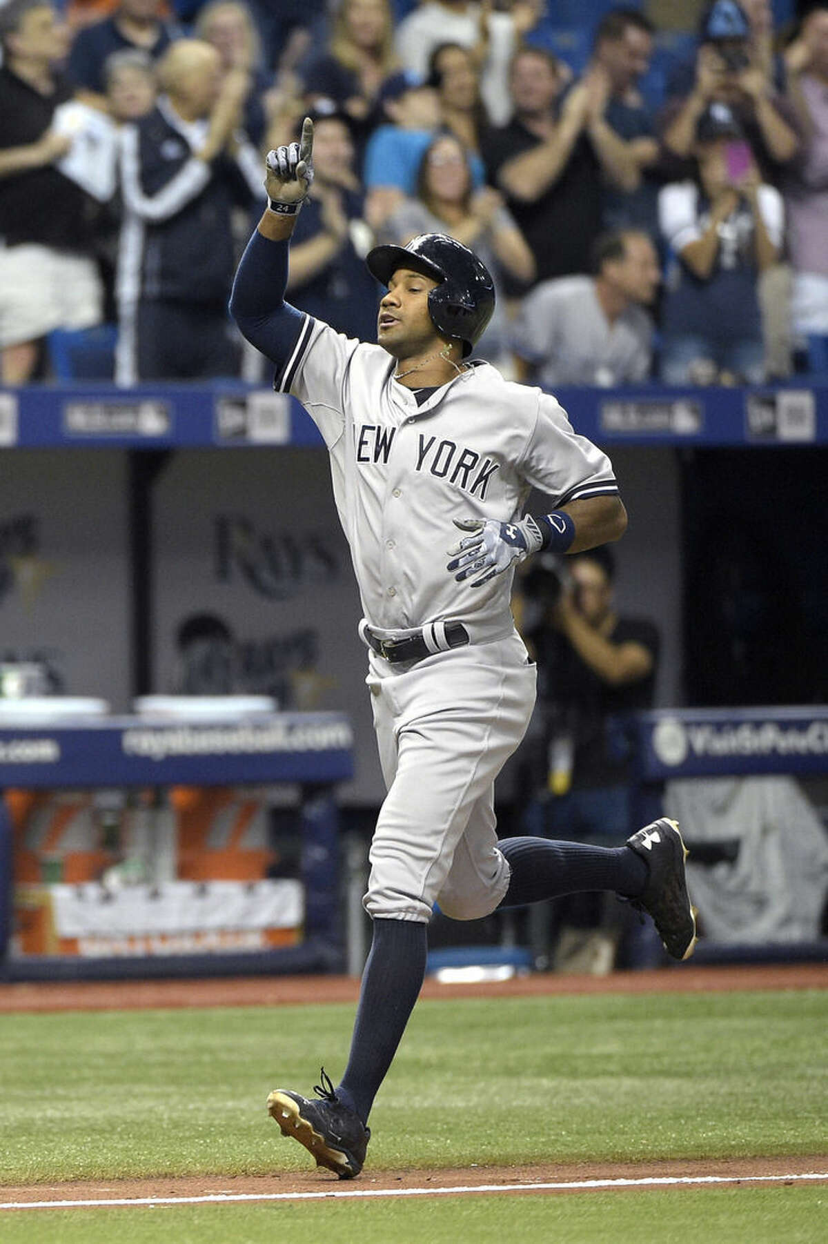New York Yankees' Chris Young points upward as he heads to home plate after hitting a grand slam during the seventh inning of a baseball game against the Tampa Bay Rays in St. Petersburg, Fla., Saturday, April 18, 2015.(AP Photo/Phelan M. Ebenhack)