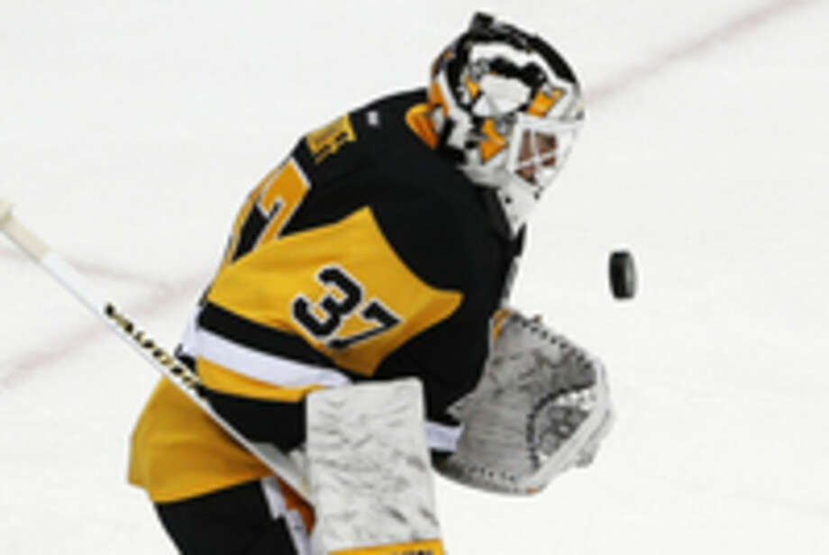 Pittsburgh Penguins goalie Jeff Zatkoff (37) stops a shot against the New York Rangers during the first period in Game 2 in the first round of the NHL Stanley Cup playoffs in Pittsburgh, Saturday, April 16, 2016. (AP Photo/Gene J. Puskar)