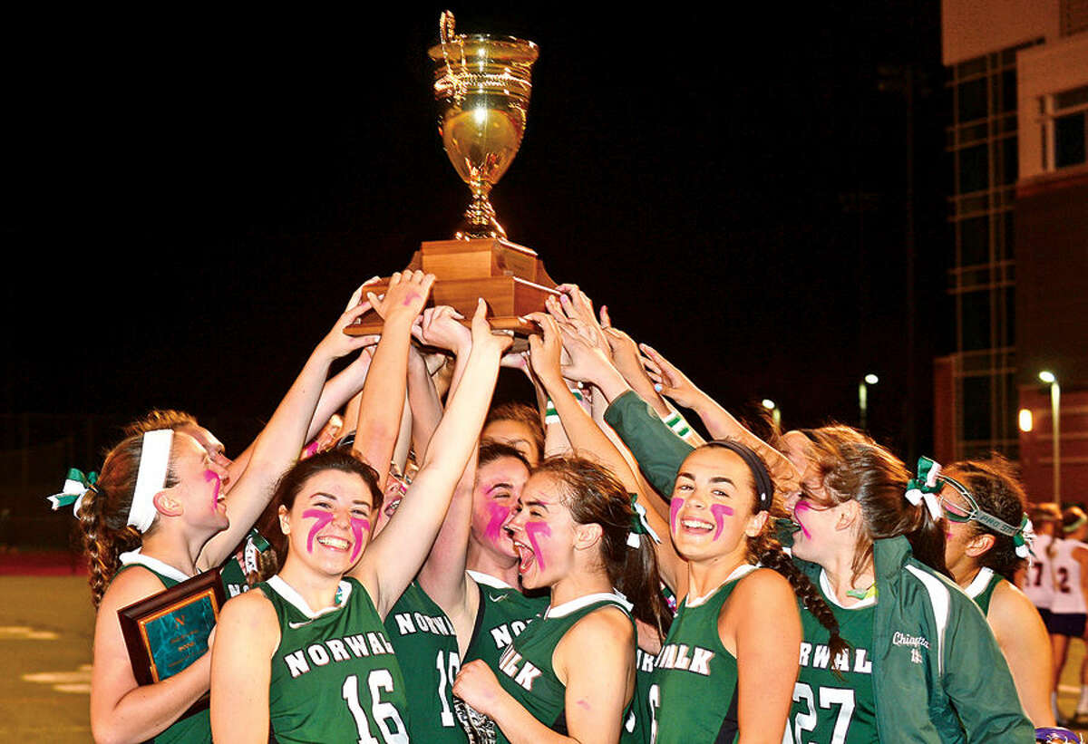 Hour photo / Erik Trautmann Norwalk High School's girls lacrosse team is awarded the second annual Kuchta Cup following their intra-city game against Brien McMahon Saturday.