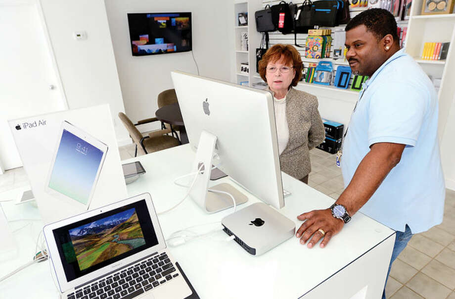Hour photo / Erik Trautmann TBI Computer owner Judy O'Meara and Sales Repersentative Dion Francis in stores new Westport Ave location.