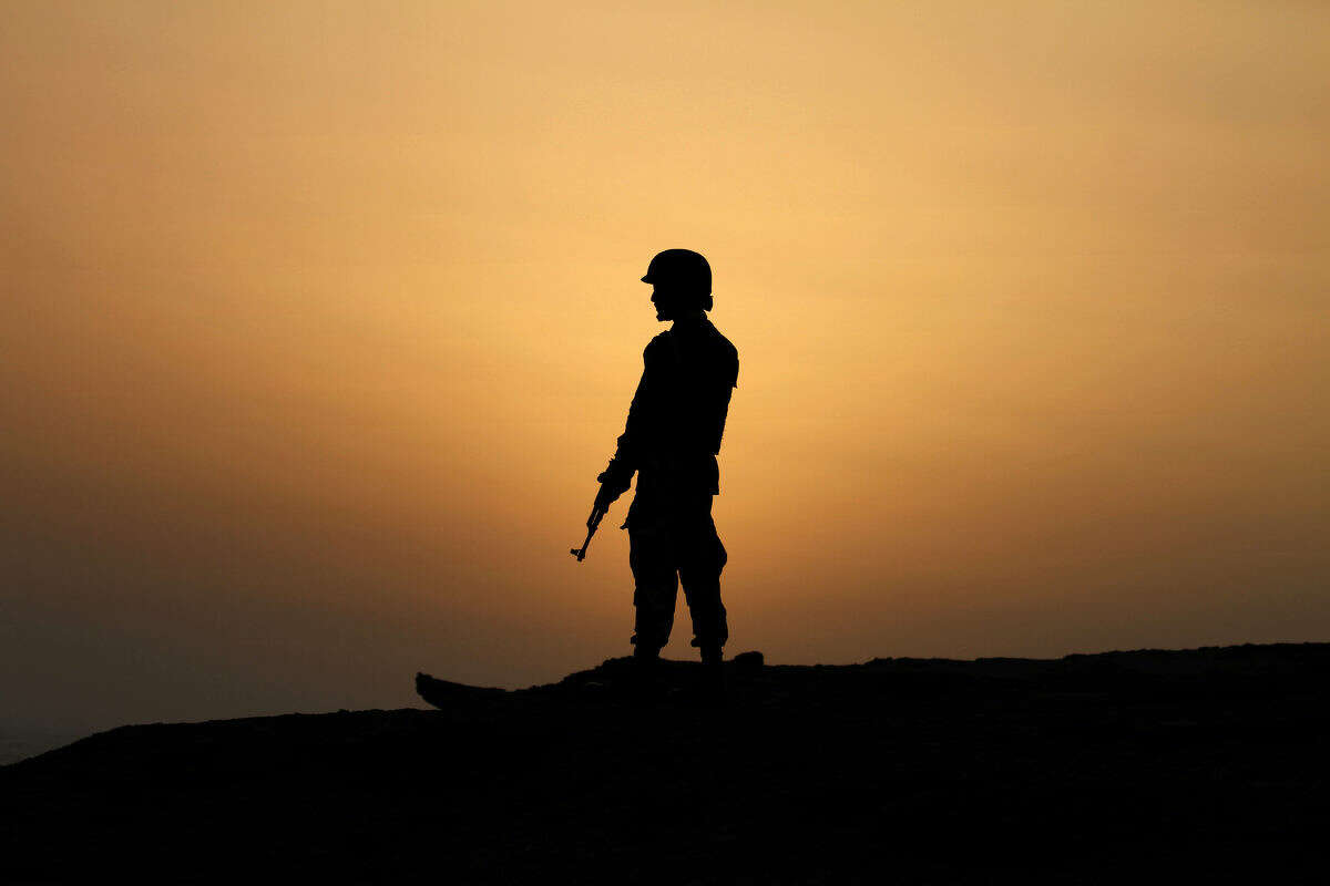 A Pakistan Navy soldier stands guard at a hilltop position near Gwadar port, about 700 kilometers (435 miles) west of Karachi. Pakistan, Monday, April 11, 2016. Gwadar Port is a deep-sea port developed jointly by the Pakistan and China at a cost of USD $248 million. In 2013, Gwadar Port operations were officially handed over to China. Gwadar is the key to the trade portion of the China Pakistan Economic Corridor, a $46 billion program in which Beijing will also build power plants in Pakistan to plug an energy shortage. (AP Photo/Anjum Naveed)