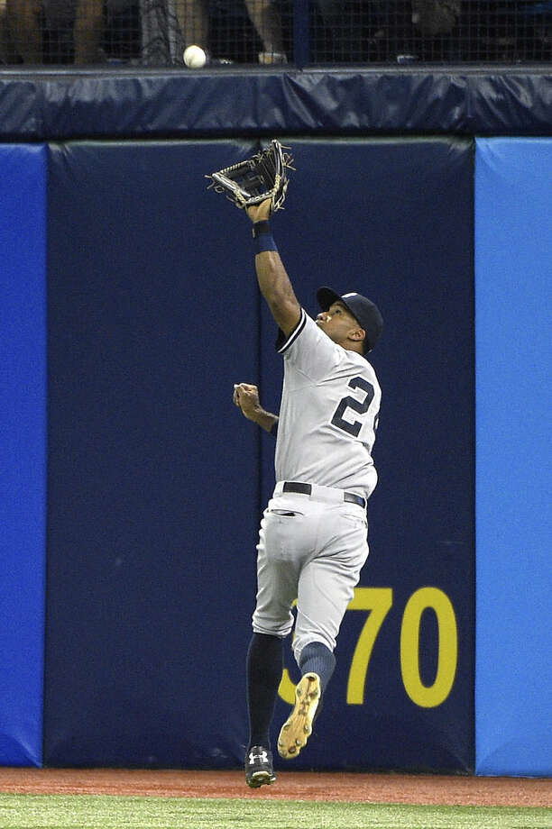 New York Yankees right fielder Chris Young catches a fly out from Tampa Bay Rays' Desmond Jennings at the warning track during the fifth inning of a baseball game in St. Petersburg, Fla., Saturday, April 18, 2015.(AP Photo/Phelan M. Ebenhack)