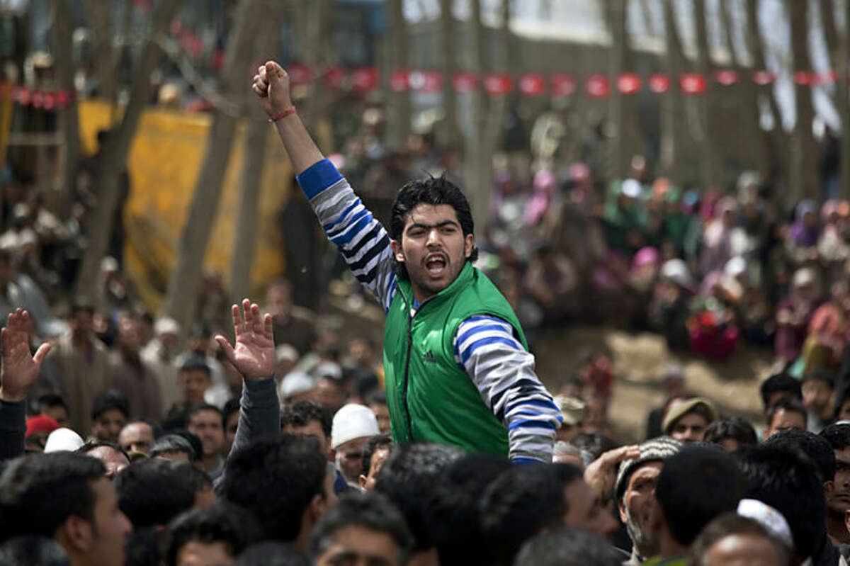 A Kashmiri activist of the National Conference party shouts slogans at an election rally on the outskirts of Srinagar, India, Tuesday, April 8, 2014. Voters in India's remote northeast cast ballots on the first day of the world's biggest election Monday, with the opposition heading into the polls with strong momentum on promises of a surge in economic growth. (AP Photo/Dar Yasin)