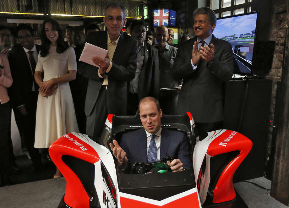 Britain's Prince William steers a Formula E simulator at an event on young entrepreneurs in Mumbai, India, Monday, April 11, 2016. The Duke and Duchess of Cambridge are on a weeklong visit to India, their first royal tour in two years. (Danish Siddiqui/Pool Photo via AP)