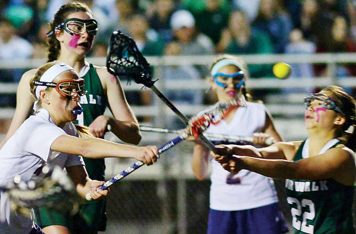 Hour photo / Erik Trautmann The Norwalk High School girls lacrosse team squares off against Brien McMahon High School in their inta-city game for the second annual Kuchta Cup.