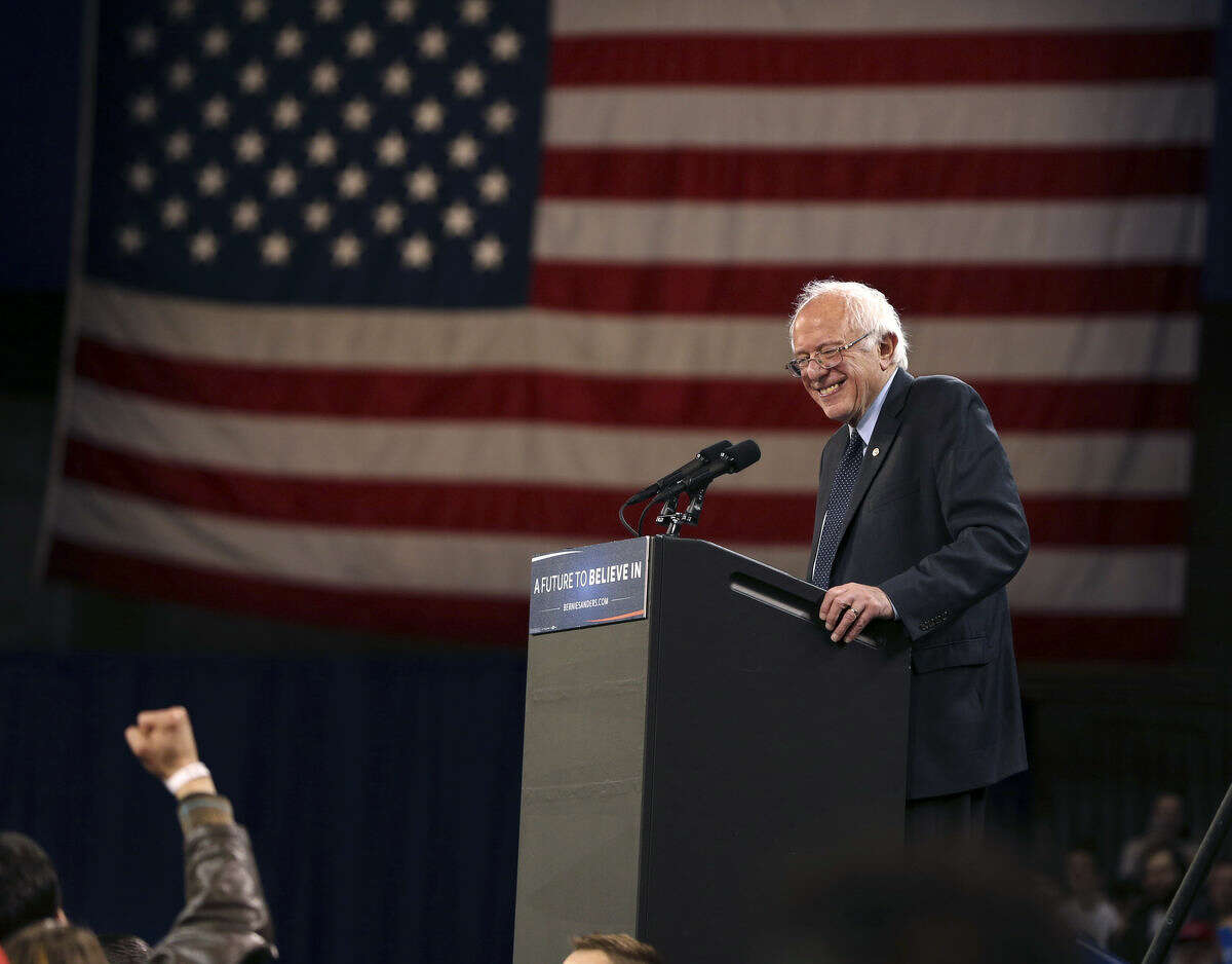 Democratic presidential candidate, Sen. Bernie Sanders, I-Vt., reacts to a fist waving supporter as he speaks at a campaign rally Monday, April 11, 2016, in Buffalo, N.Y. (AP Photo/Mel Evans)