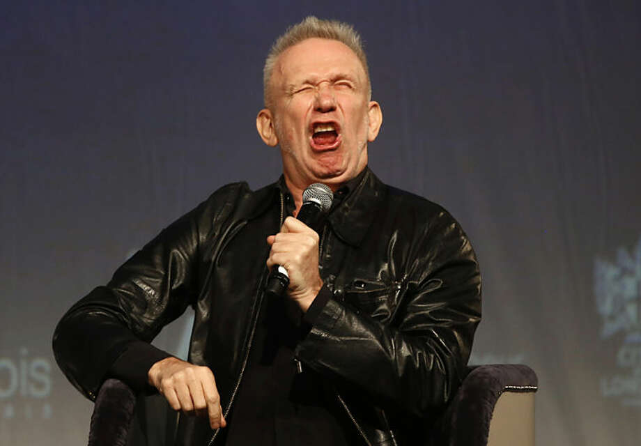 French couturier Jean Paul Gaultier pulls a face as he speaks to the media during a Q&A session during the launch of his exhibition 'The Fashion World of Jean Paul Gaultier : From the Sidewalk to the Catwalk' at the Barbican Art Gallery in London, Tuesday, April 8, 2014. (AP Photo/Sang Tan)