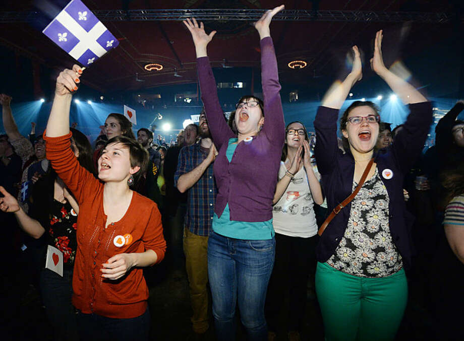 Quebec Solidaire supporters react to the provincial election results at the party's headquarters in Montreal, on Monday, April 7, 2014. The Liberal Party won Quebec's legislative elections Monday, in a crushing defeat for the main separatist party and major setback for the cause of independence in the French-speaking province. Official results showed the Liberals, staunch supporters of Canadian unity, won or were leading the race in about 75 of the of National Assembly's 125 seats, outstripping the separatist Parti Quebecois. (AP Photo/The Canadian Press, Sean Kilpatrick)