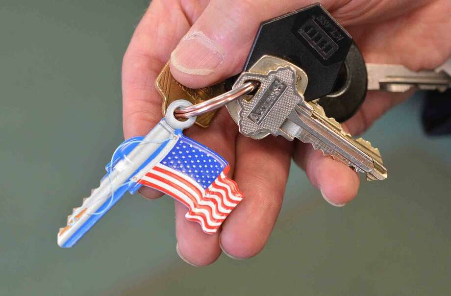 Hour Photo/Alex von Kleydorff Mayor Rillings new American flag key just cut for him at Cross River Locksmith