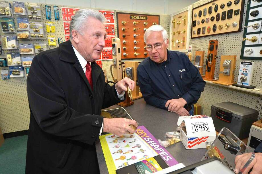 Hour Photo/Alex von Kleydorff Mayor Harry Rilling talks about his job working for New England Lock and Hardware while looking over a new Segal lock with Cross River Locksmith Co Owner Andy Karwoski at their 177 Main Ave. Norwalk location