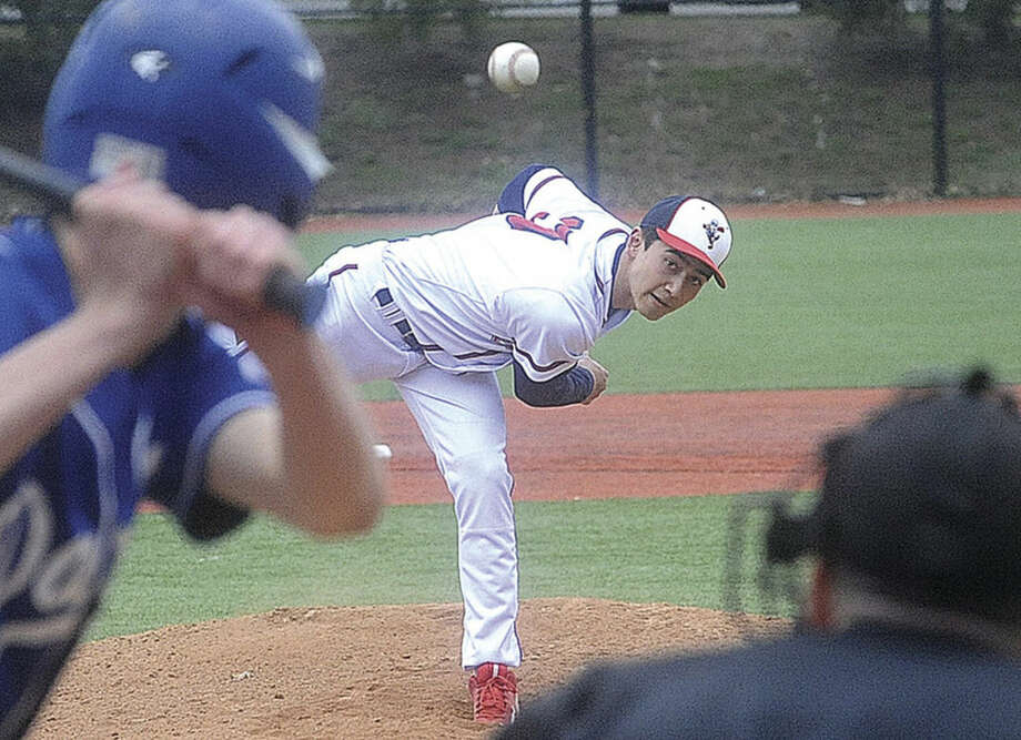Hour photo/Matthew VinciEthan Blattman, starting pitcher for the Brien McMahon Senators, fires a pitch to the plate during Monday's game against the Darien Blue Wave in Darien.