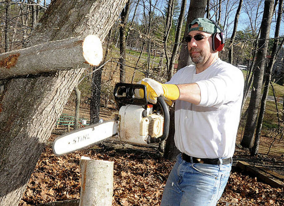 Volunteer Pat Costanzo trimming trees Sunday at the Camp Mahackeno Clean-Up Day in Westport. Hour photo/Matthew Vinci