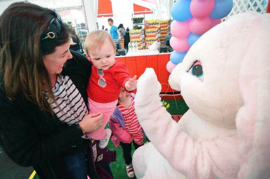 Hour Photo/Alex von Kleydorff 1 Year old Stella Hinton meets the Easter Bunny with mom Annie during Stew leonard's Eggs-Travaganza Easter Egg hunt on Tuesday