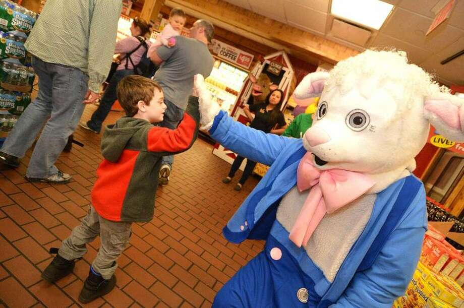 Hour Photo/Alex von Kleydorff Barnyard characters filled the store during Stew leonard's Eggs-Travaganza Easter Egg hunt on Tuesday
