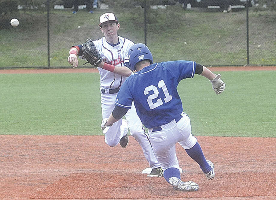 Hour photo/Matthew VinciBrien McMahon shortstop Chris Giordano forces Darien's Peter Marren at second base during Monday's game.
