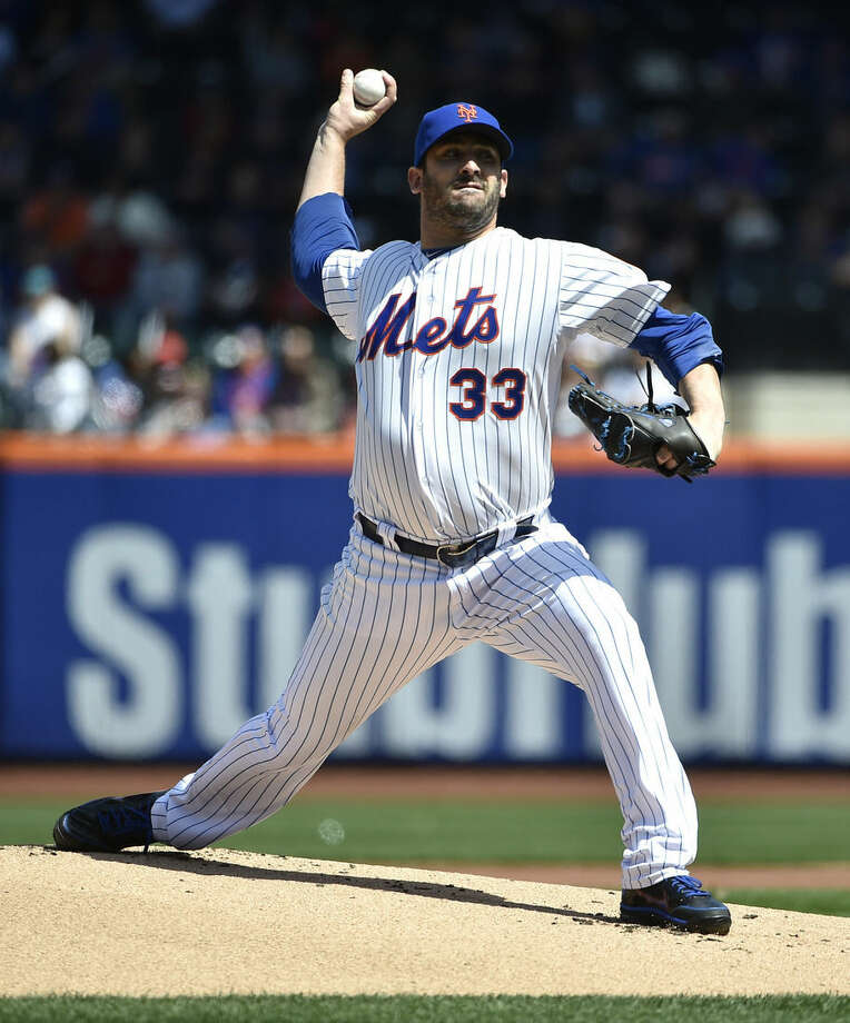 New York Mets starter Matt Harvey (33) pitches against the Miami Marlins in the first inning of a baseball game at Citi Field on Sunday, April 19, 2015, in New York. (AP Photo/Kathy Kmonicek)