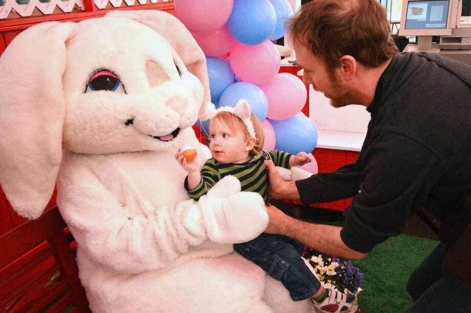 Hour Photo/Alex von Kleydorff Griffin Rice offers the Easter Bunny his egg during Stew leonard's Eggs-Travaganza Easter Egg hunt on Tuesday