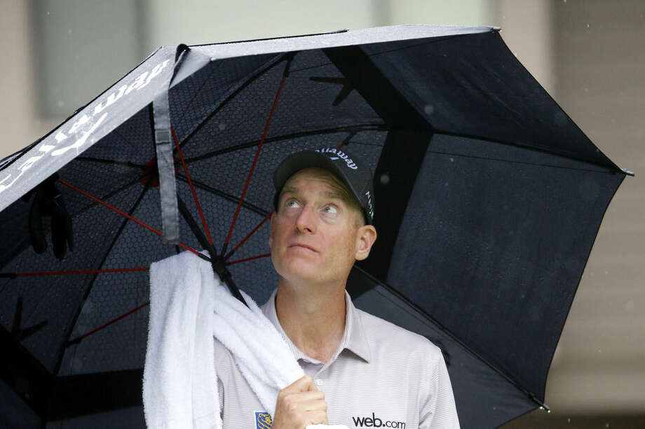 Jim Furyk checks the clouds before he drives off the third tee during the final round of the RBC Heritage golf tournament in Hilton Head Island, S.C., Sunday, April 19, 2015. (AP Photo/Stephen B. Morton)